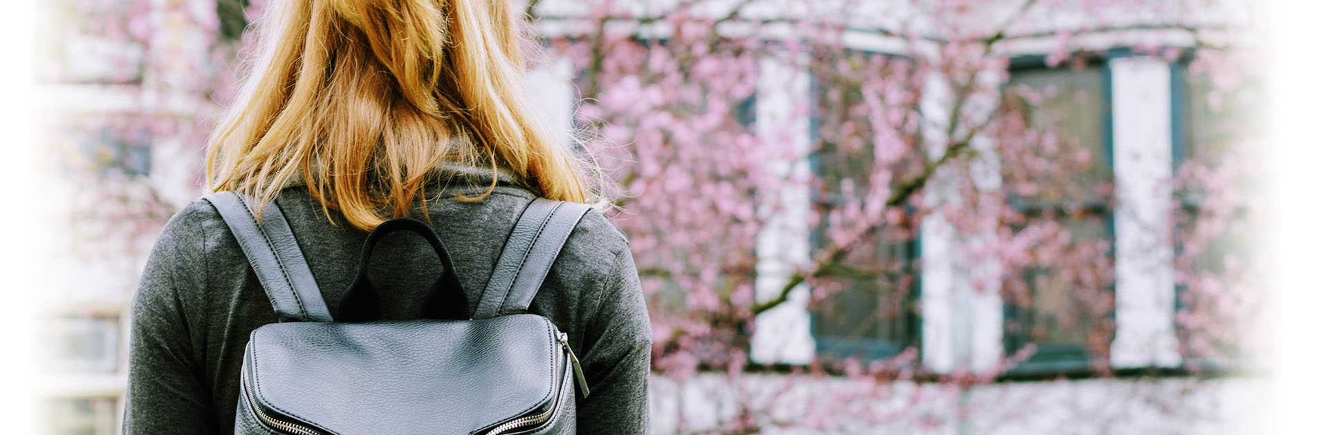 Student facing the other way with a backpack on her back