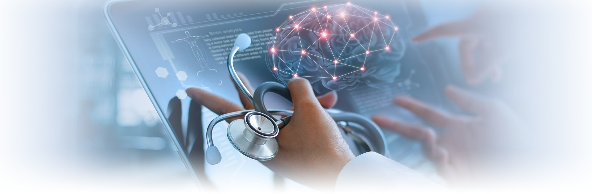 Hand holding stethoscope with brain on screen.