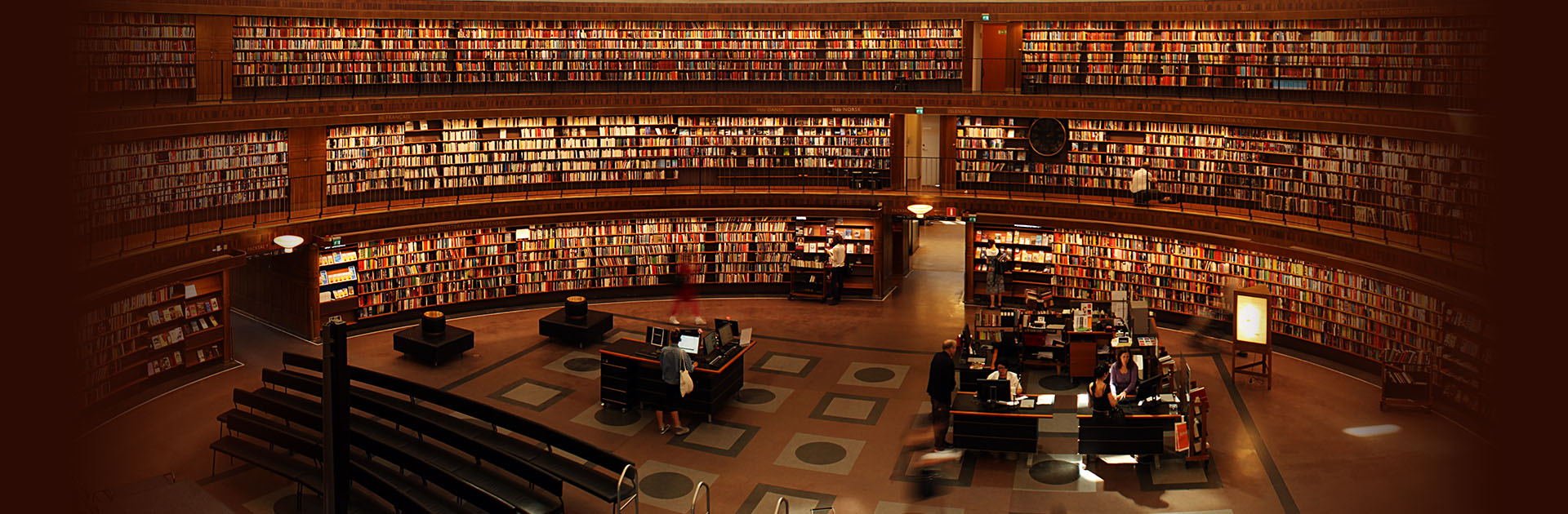 Inside a library with many books